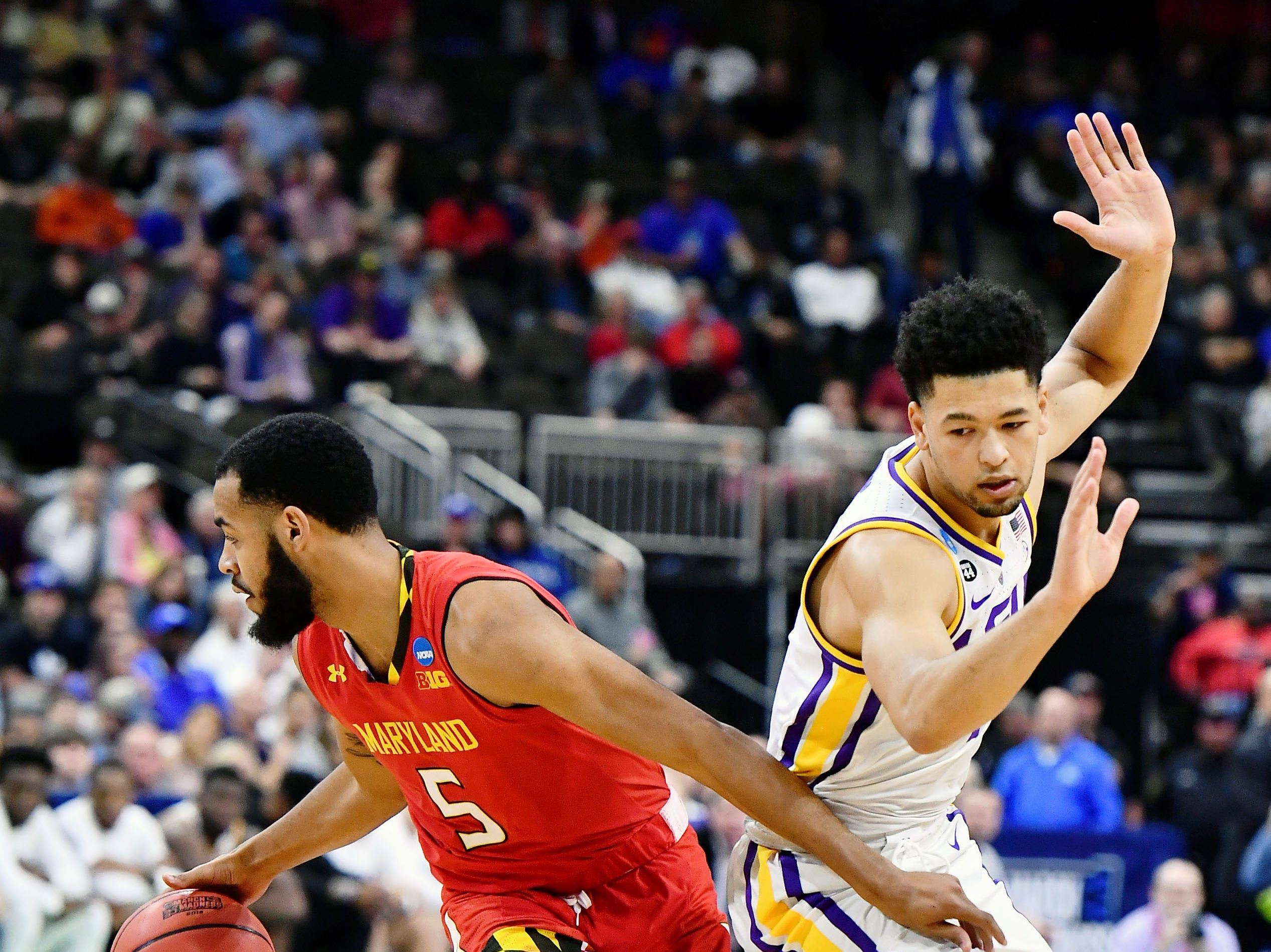 Mar 23, 2019; Jacksonville, FL, USA; Maryland Terrapins guard Eric Ayala (5) dribbles around LSU Tigers guard Skylar Mays (4) during the second half in the second round of the 2019 NCAA Tournament at Jacksonville Veterans Memorial Arena. Mandatory Credit: John David Mercer-USA TODAY Sports
