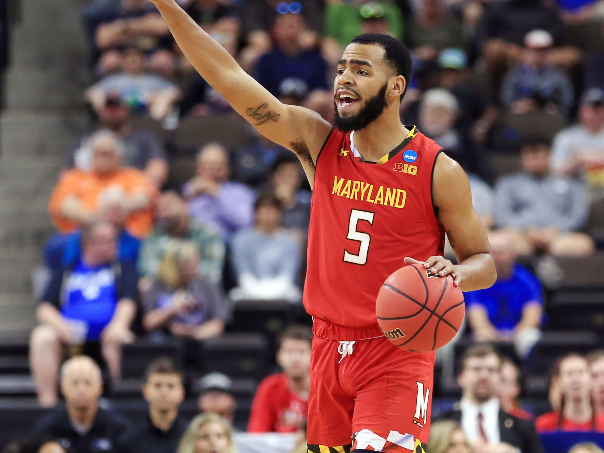 Mar 23, 2019; Jacksonville, FL, USA; Maryland Terrapins guard Eric Ayala (5) signals a play against the LSU Tigers during the first half in the second round of the 2019 NCAA Tournament at Jacksonville Veterans Memorial Arena. Mandatory Credit: Matt Stamey-USA TODAY Sports