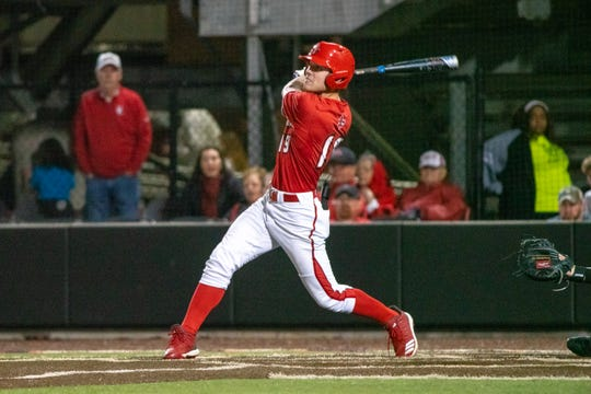 """UL's Hunter Kasuls watches his hit as the Ragin' Cajuns take on the Appalachian State Mountaineers at M.L. """"Tigue"""" Moore Field on Friday, March 22, 2019."""