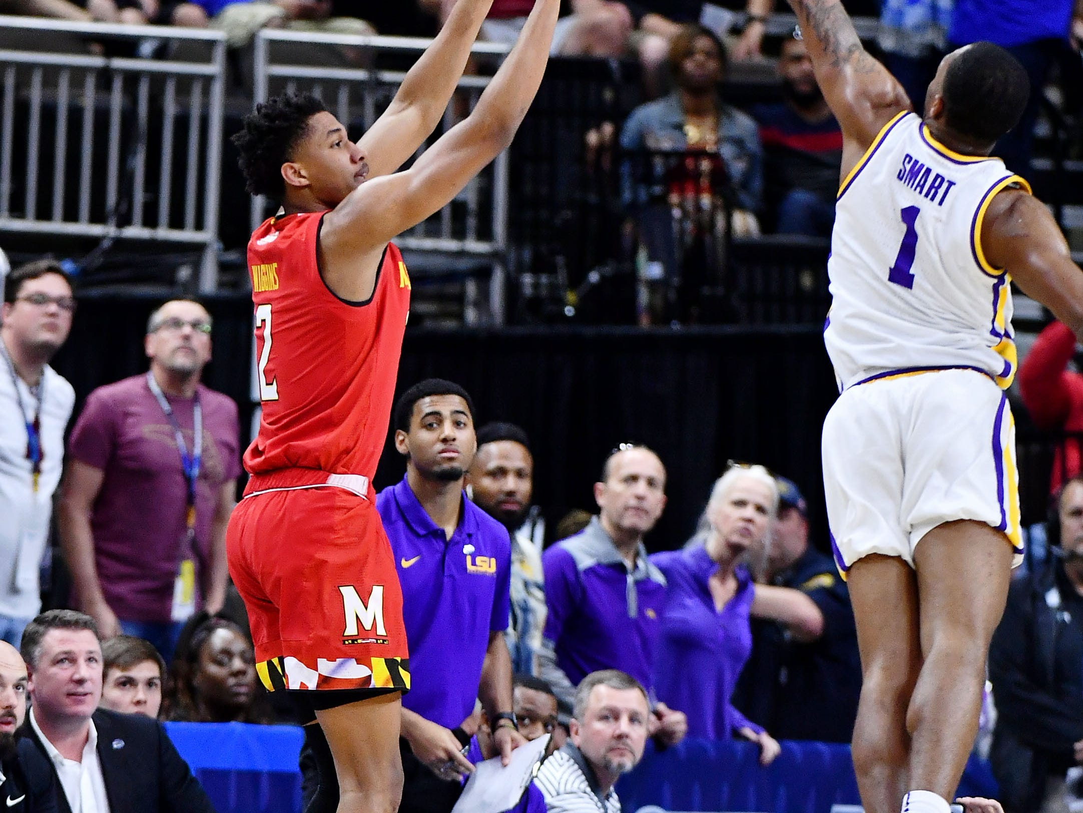 Mar 23, 2019; Jacksonville, FL, USA; Maryland Terrapins guard Aaron Wiggins (2) shoots while LSU Tigers guard Javonte Smart (1) attempts to block during the first half in the second round of the 2019 NCAA Tournament at Jacksonville Veterans Memorial Arena. Mandatory Credit: John David Mercer-USA TODAY Sports