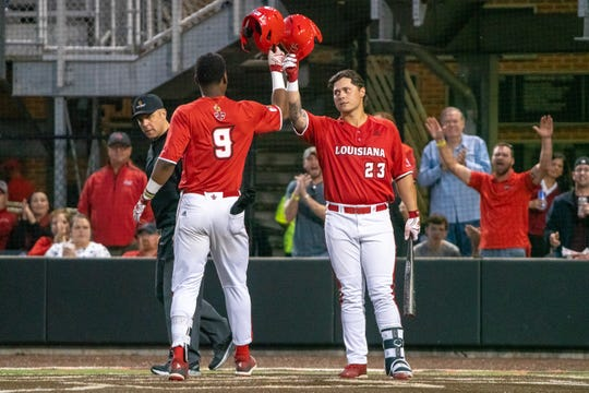 UL's Todd Lott (9) is commended by Handsome Monica (23) after his home run March 22 against Appalachian State.