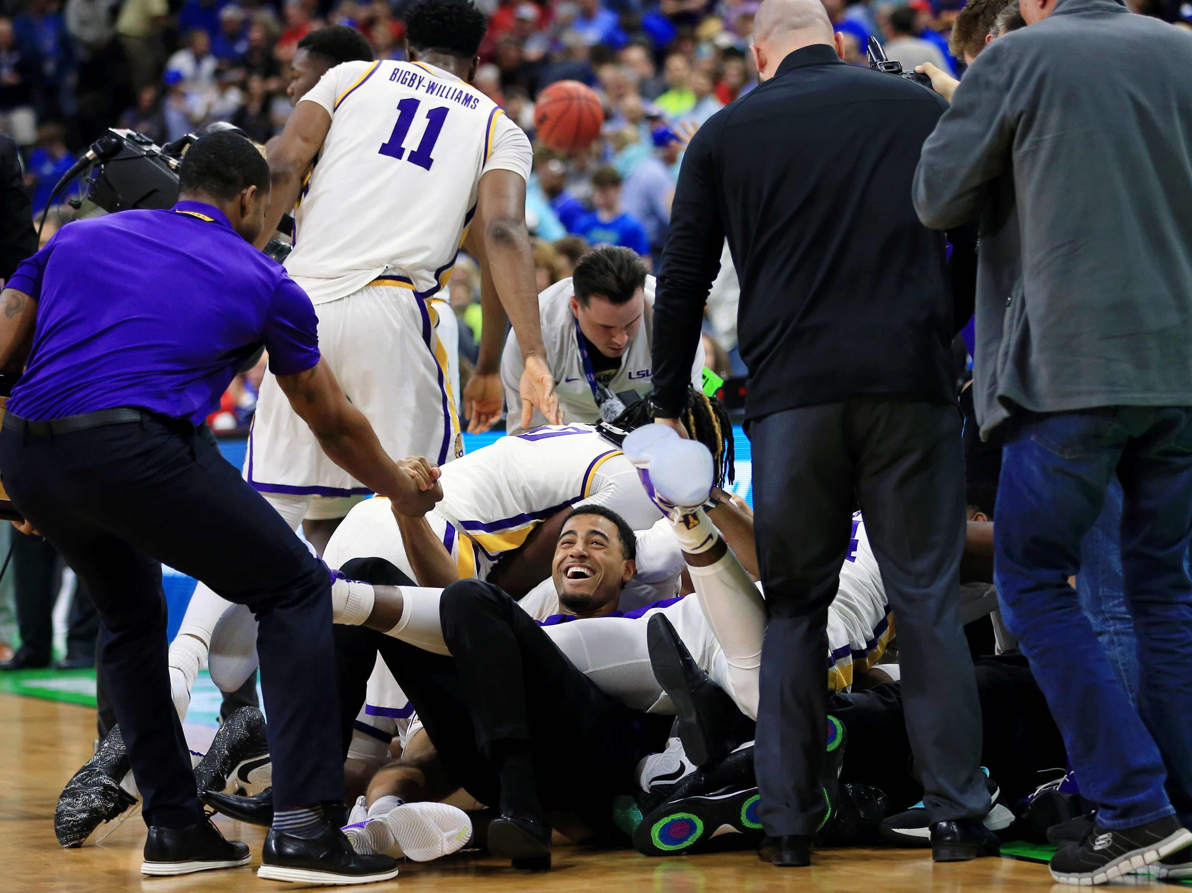 Mar 23, 2019; Jacksonville, FL, USA; The LSU Tigers celebrate their win over the Maryland Terrapins in the second round of the 2019 NCAA Tournament at Jacksonville Veterans Memorial Arena. The LSU Tigers won 69-67. Mandatory Credit: Matt Stamey-USA TODAY Sports