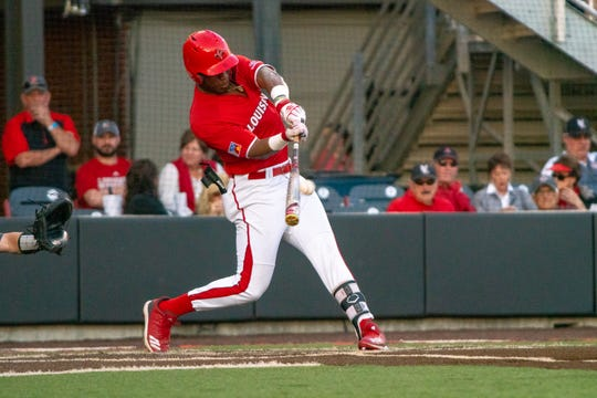 """UL's Todd Lott connects with the pitch as the Ragin' Cajuns take on the Appalachian State Mountaineers at M.L. """"Tigue"""" Moore Field on Friday, March 22, 2019."""