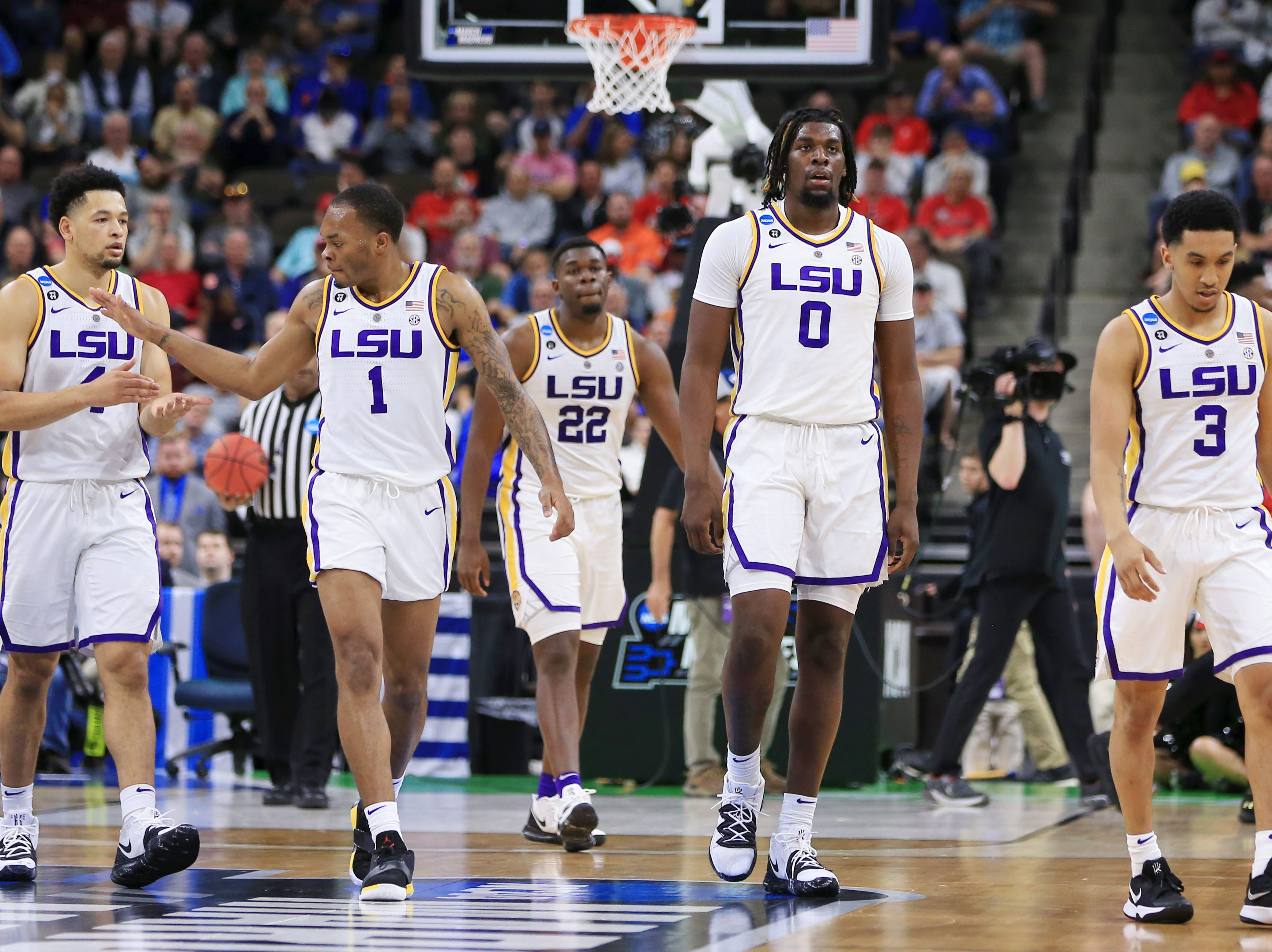 Mar 23, 2019; Jacksonville, FL, USA; LSU Tigers guard Skylar Mays (4) and guard Javonte Smart (1) high five as the team walks off the court during the first half of their game against the Maryland Terrapins in the second round of the 2019 NCAA Tournament at Jacksonville Veterans Memorial Arena. Mandatory Credit: Matt Stamey-USA TODAY Sports