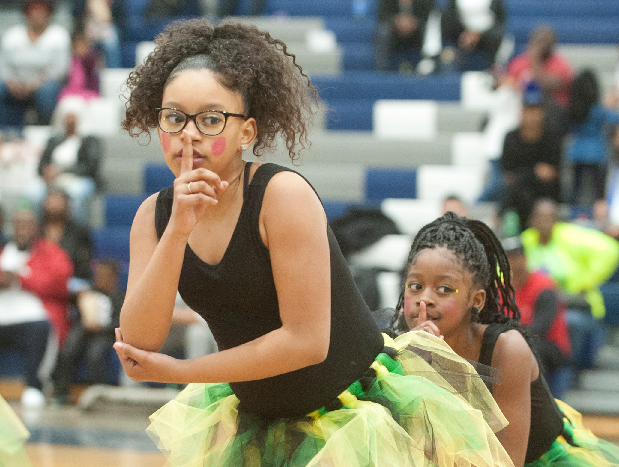 Kennedy Elementary 5th grader Aliviah Moore and her step teammates ask for quiet during a Barbie doll sleep sequence at StepFest, a Kentucky Derby Festival event sponsored by Louisville Parks and Recreation and held at Moore Traditional High School.