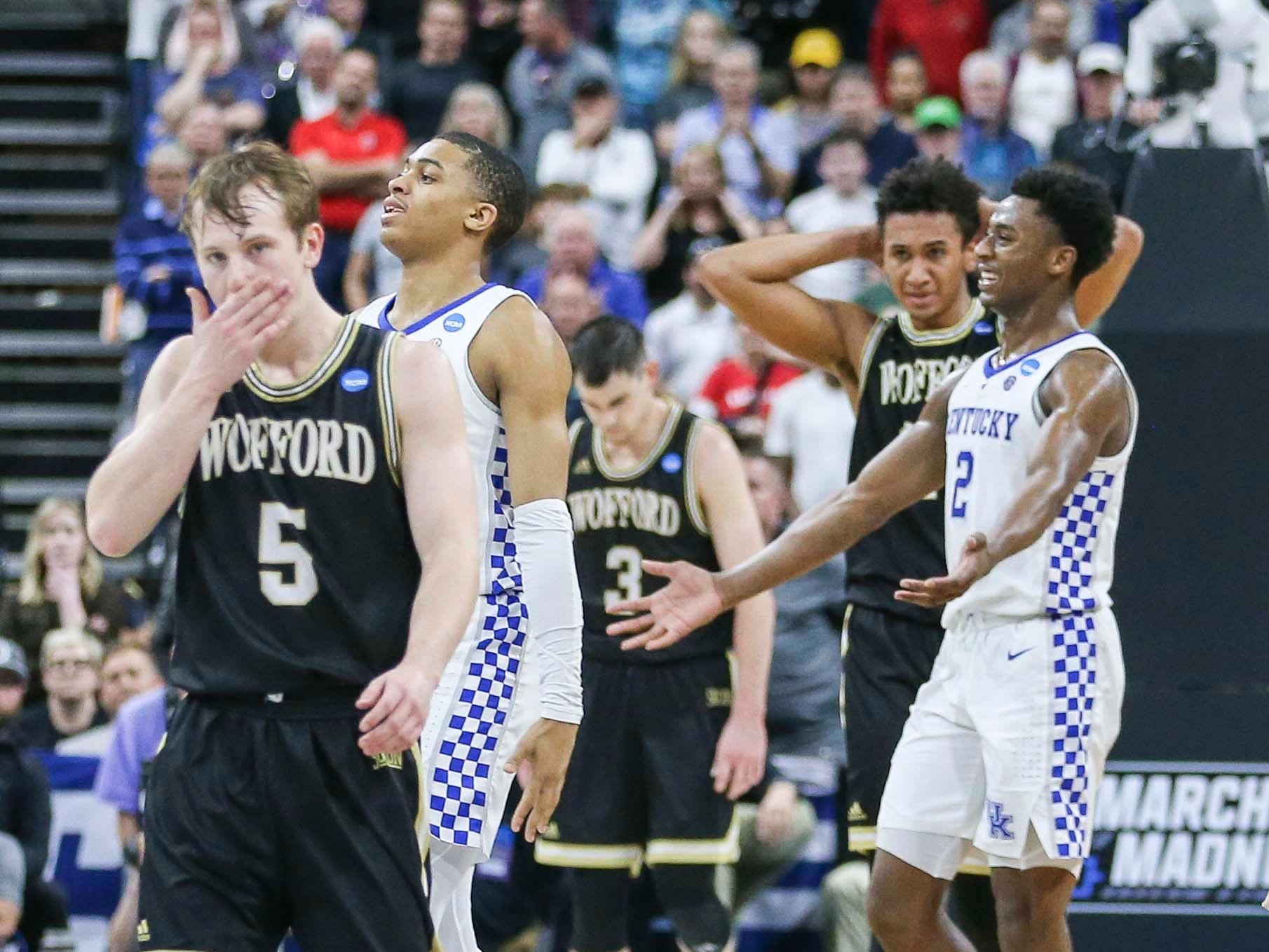 Kentucky players celebrate after the Wildcats beat a tenacious Wofford 62-56 in the second round game of the 2019 NCAA tournament in Jacksonville, Fla. March 23, 2019
