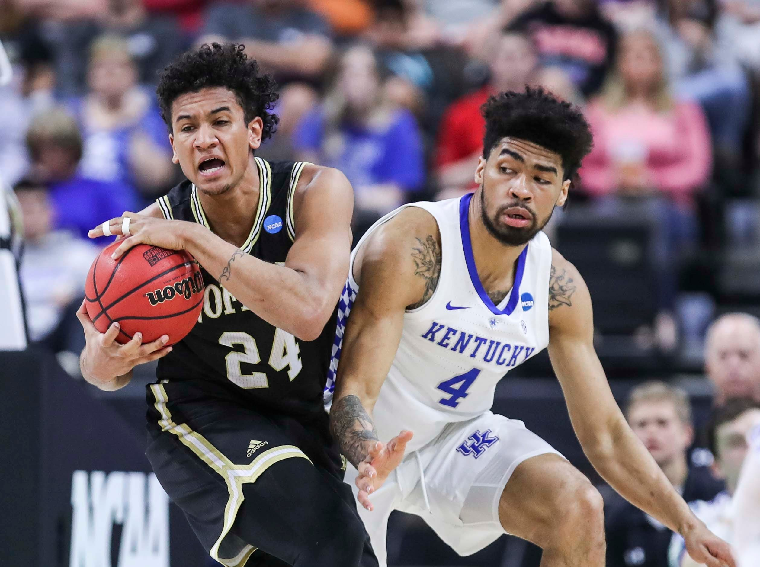 Kentucky's Nick Richards guards Wofford's Keve Aluma in the first half against Wofford in the second round game of the 2019 NCAA tournament in Jacksonville, Fla. March 23, 2019