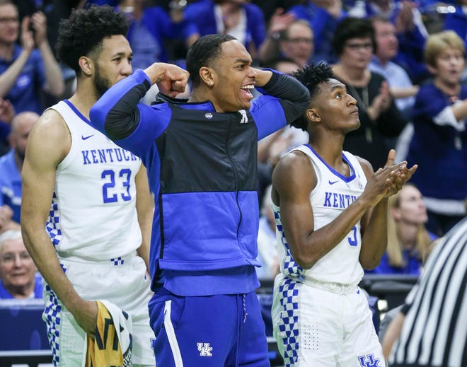 PJ Washington flexes in celebration as Kentucky muscled its way past a tenacious Wofford 62-56 in the second round game of the 2019 NCAA tournament in Jacksonville, Fla. March 23, 2019