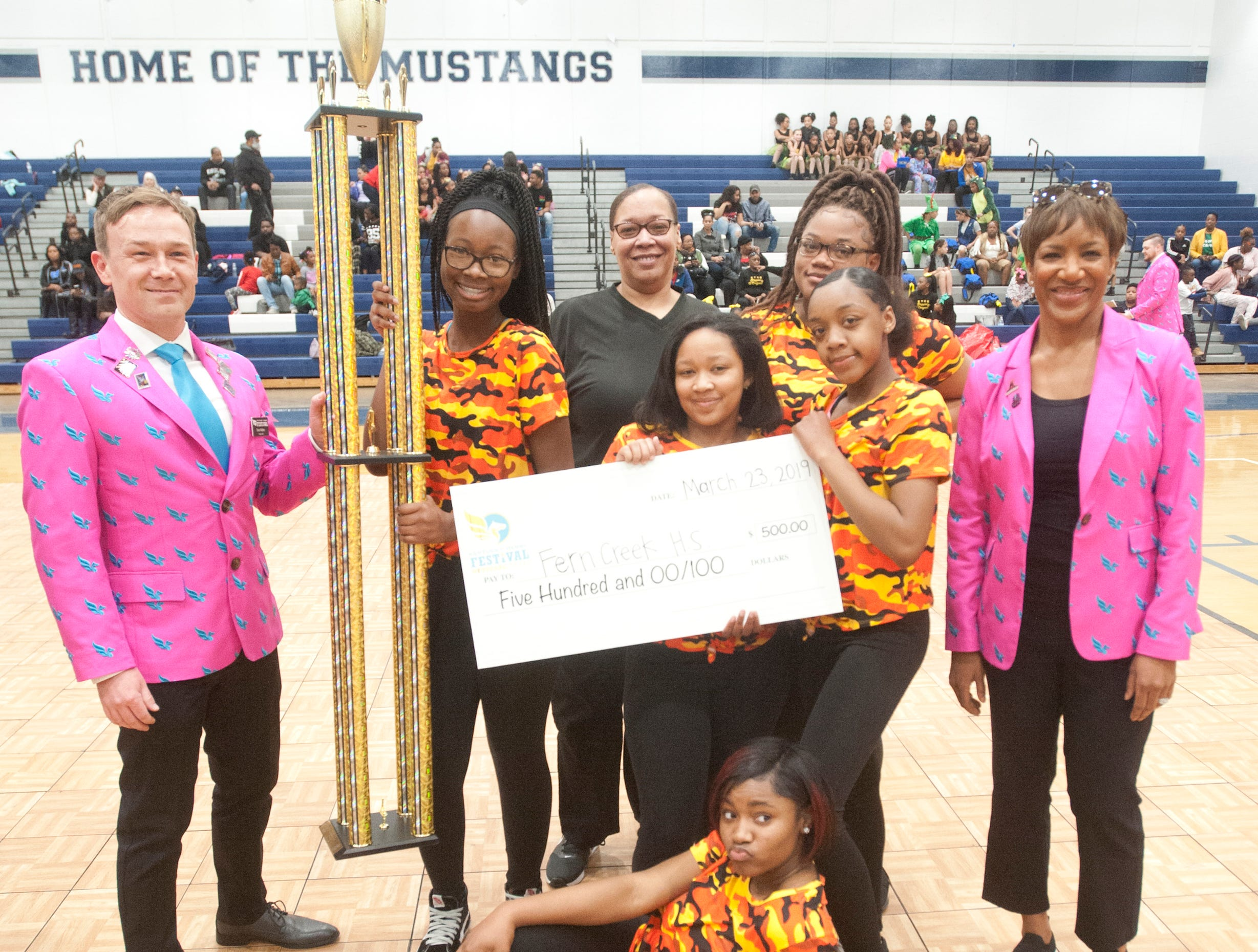 The Fern Creek Tigers Stepping Team posed after winning the high school category at StepFest, a Kentucky Derby Festival event sponsored by Louisville Parks and Recreation and held at Moore Traditional High School.