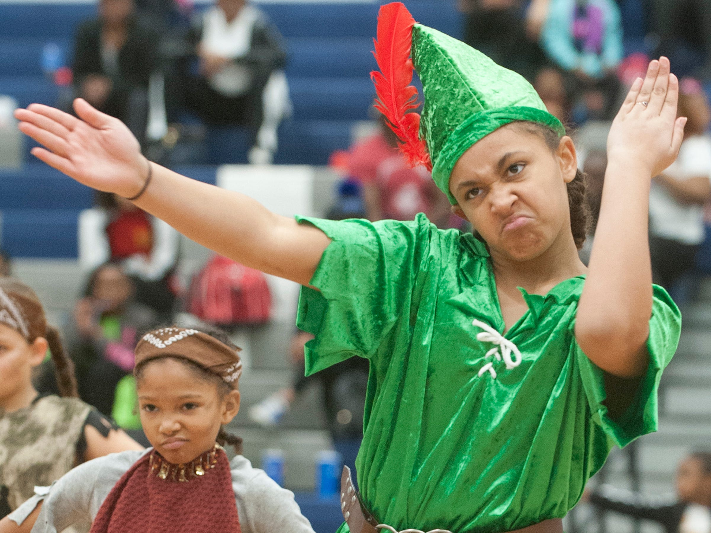 Semple Elementary 5th grader Jaylin Jackson, as Peter Pan, performs at StepFest, a Kentucky Derby Festival event sponsored by Louisville Parks and Recreation and held at Moore Traditional High School. The team took 1st place in the elementary school category.