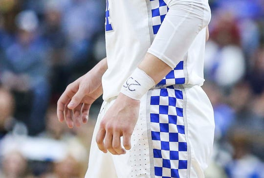 Kentucky's Tyler Herro had PJ Washington Jr.'s number written on his taped wrist as the Wildcats beat a tenacious Wofford 62-56 in the second round game of the 2019 NCAA tournament in Jacksonville, Fla. March 23, 2019