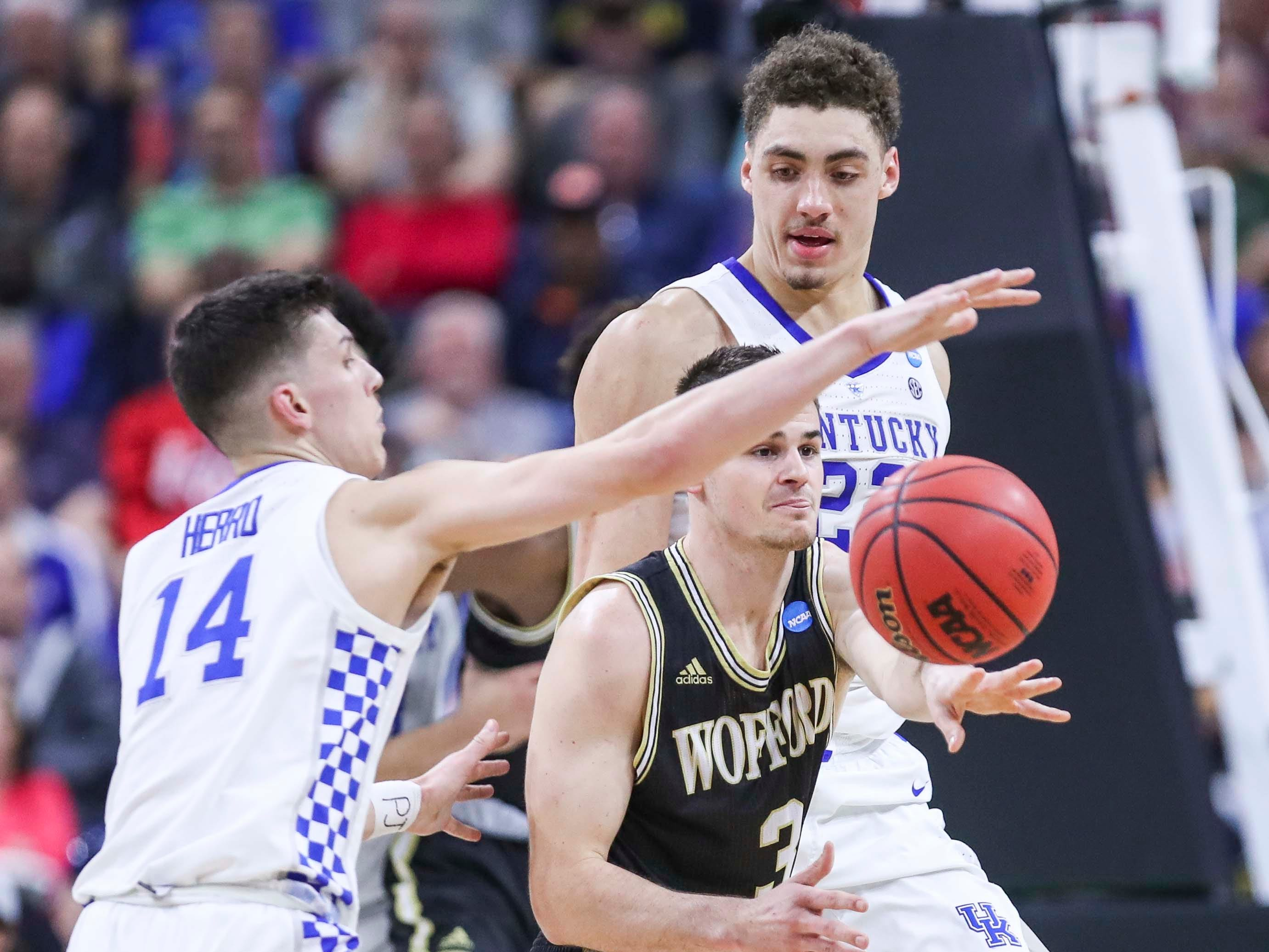 Kentucky's Tyler Herro pressures Wofford's Fletcher Magee as the Wildcats muscled its way past a tenacious Wofford 62-56 in the second round game of the 2019 NCAA tournament in Jacksonville, Fla. March 23, 2019