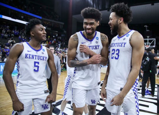 Kentucky's Nick Richards smiles as he walks with teammates Immanuel Quickley, left, and EJ Montgomery after the Wildcats beat Wofford in the second round game of the 2019 NCAA tournament in Jacksonville, Fla. March 23, 2019