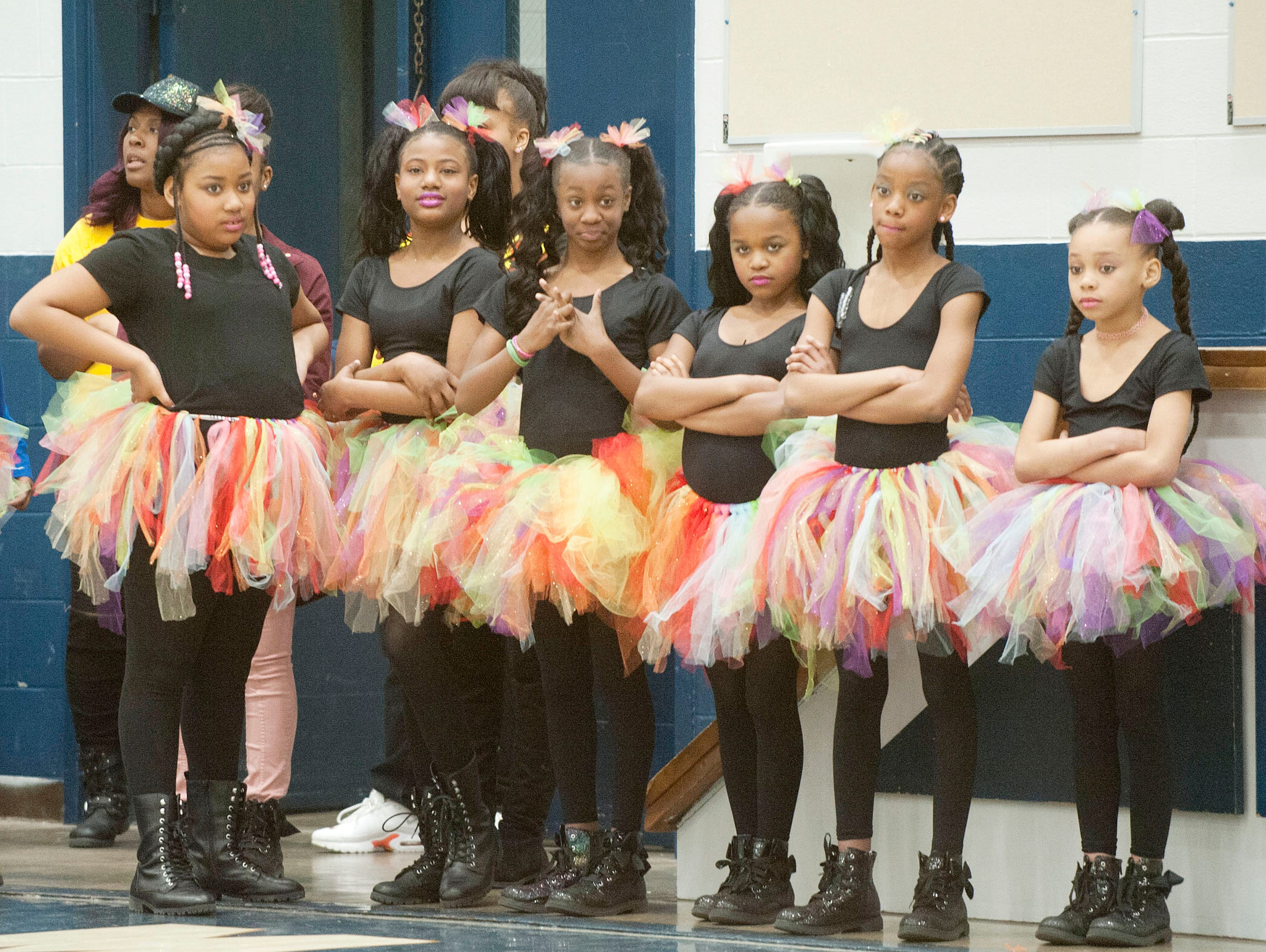 Cooleridge Taylor's Lady Titans step team waits to perform at the side of the gym at StepFest, a Kentucky Derby Festival event sponsored by Louisville Parks and Recreation and held at Moore Traditional High School.