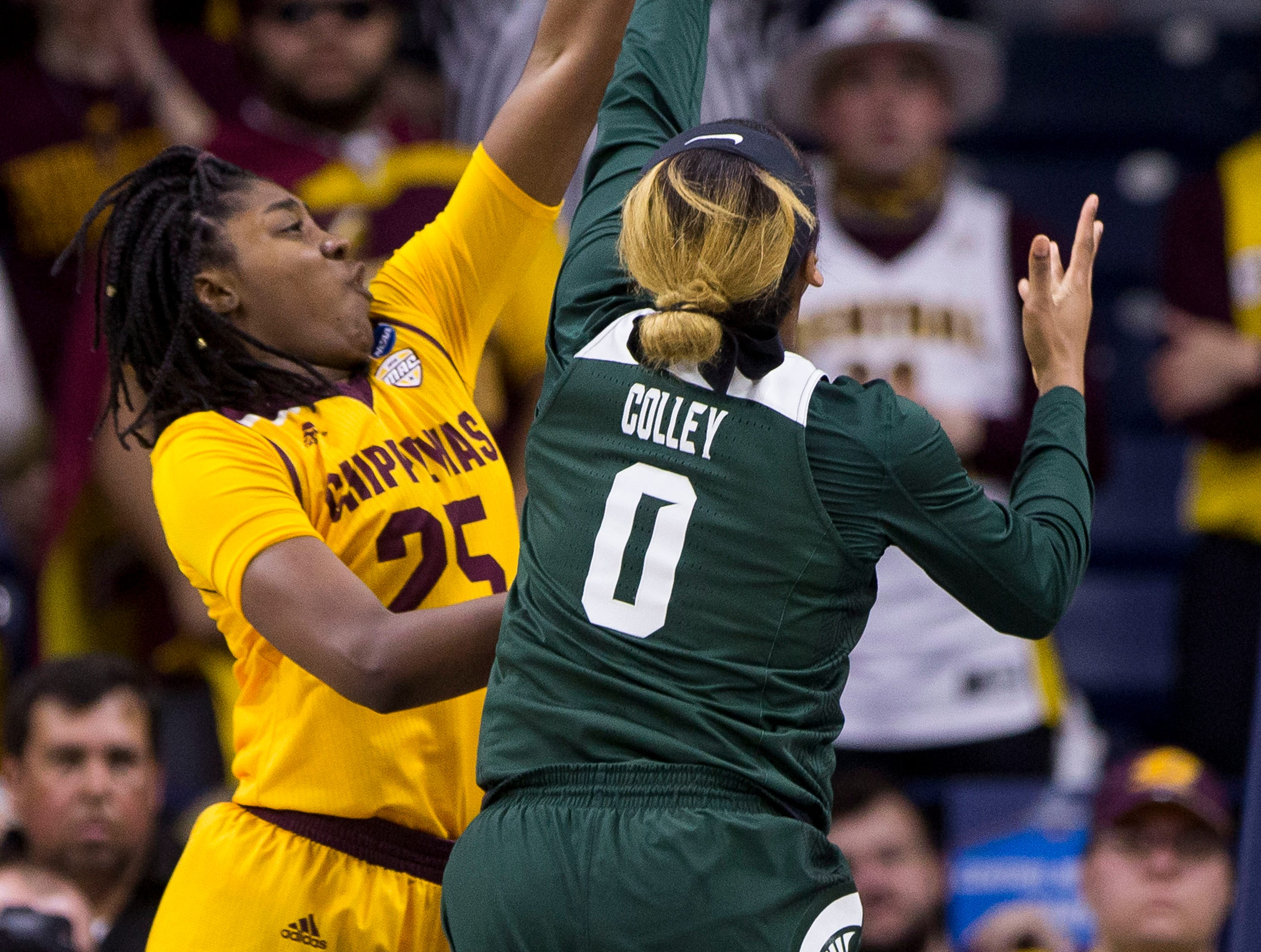Central Michigan's Jahari Smith (25) blocks a shot by Michigan State's Shay Colley (0) during a first-round game in the NCAA women's college basketball tournament in South Bend, Ind., Saturday, March 23, 2019.