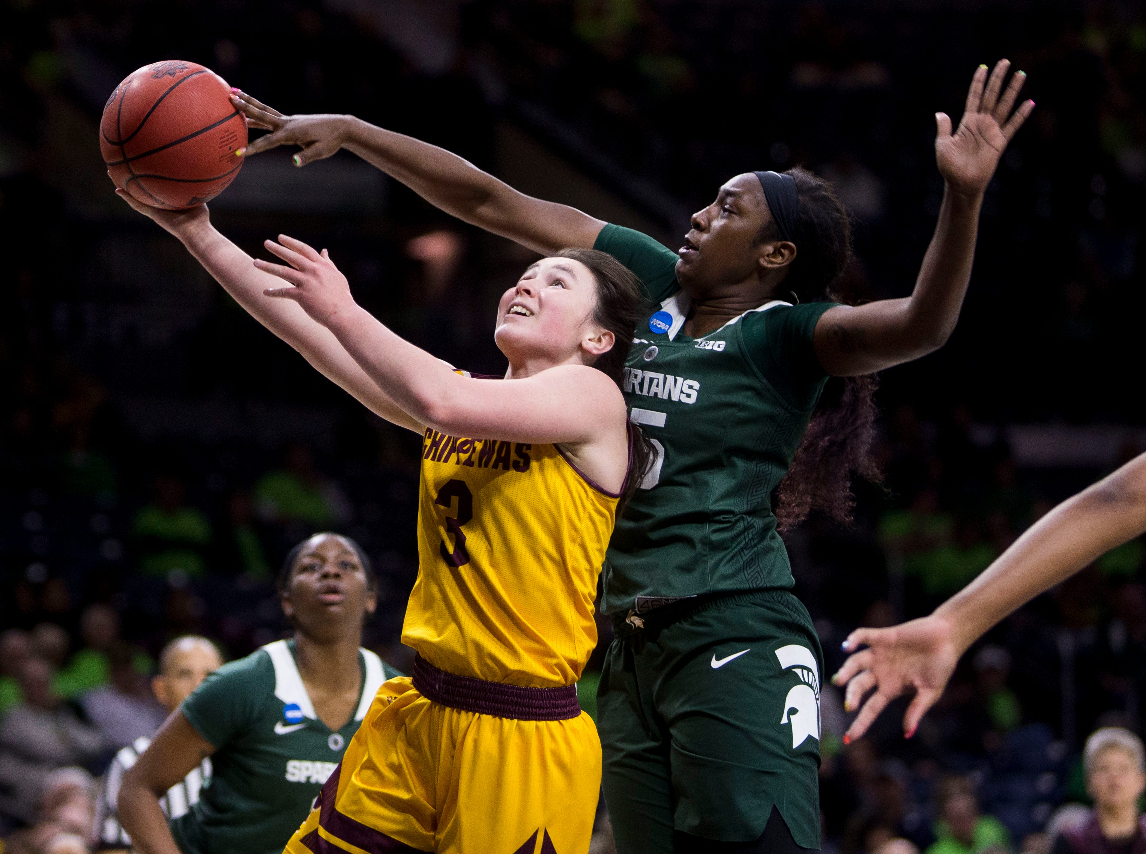 Michigan State's Victoria Gaines, right, blocks a shot by Central Michigan's Presley Hudson (3) during a first-round game in the NCAA women's college basketball tournament in South Bend, Ind., Saturday, March 23, 2019. Michigan State won 88-87.