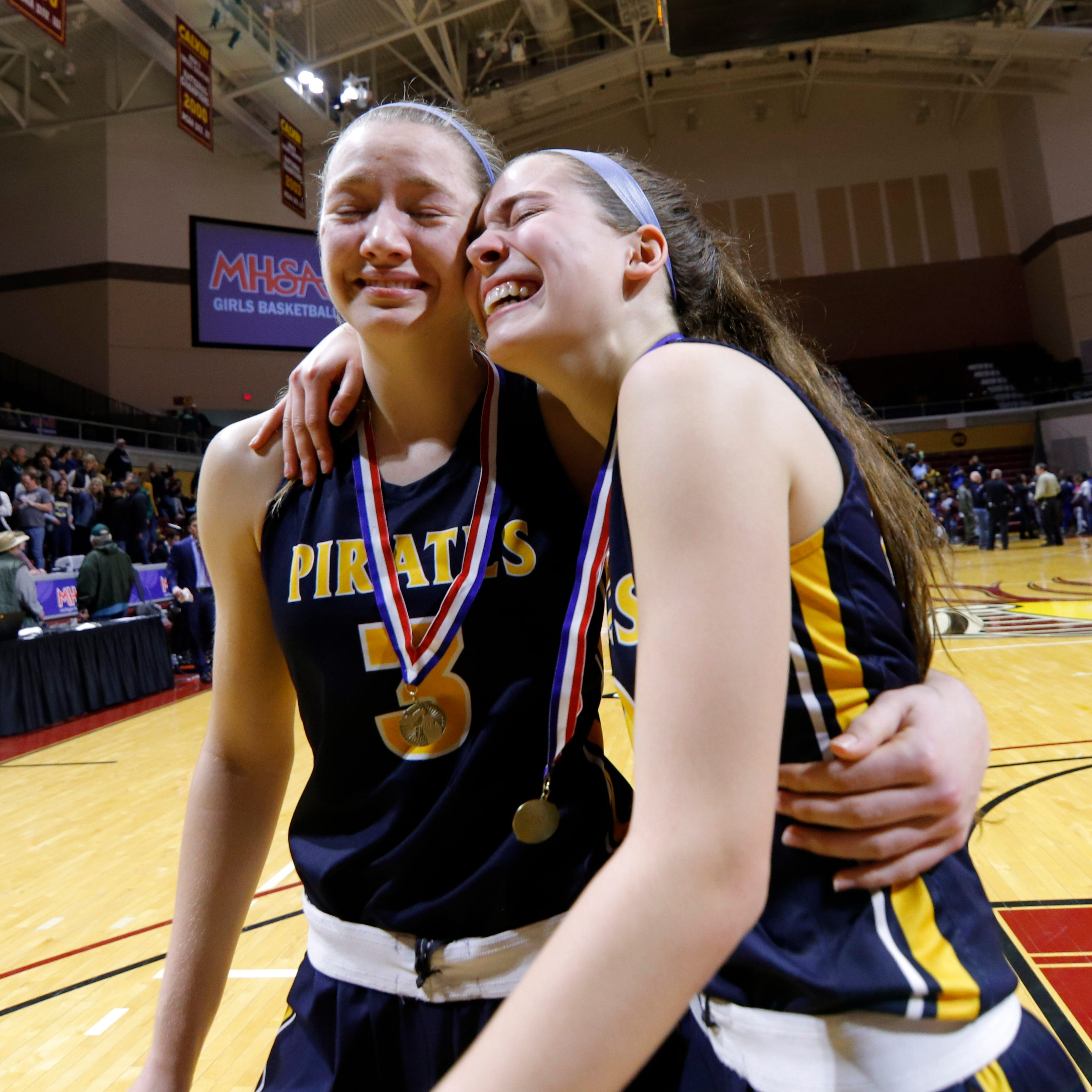 Pewamo-Westphalia's Ellie Droste, right, and Hannah Spitzley react as they walk off the court after winning the MHSAA Division 3 championship, Saturday, March 23, 2019, in Grand Rapids, Mich. P-W won 40-33.