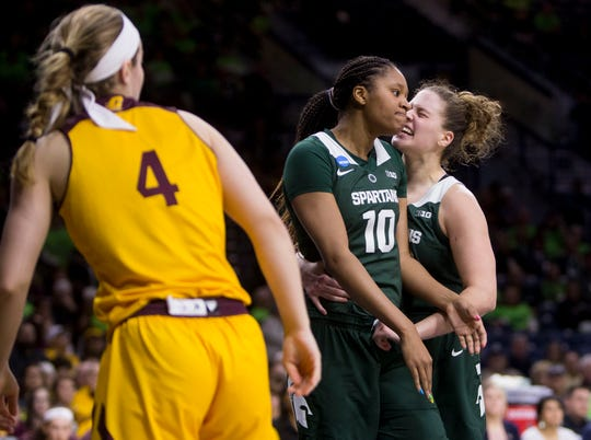 Michigan State's Sidney Cooks (10) and Jenna Allen celebrate next to Central Michigan's Maddy Watters (4) during a first-round game in the NCAA women's college basketball tournament in South Bend, Ind., Saturday, March 23, 2019. Michigan State won 88-87.