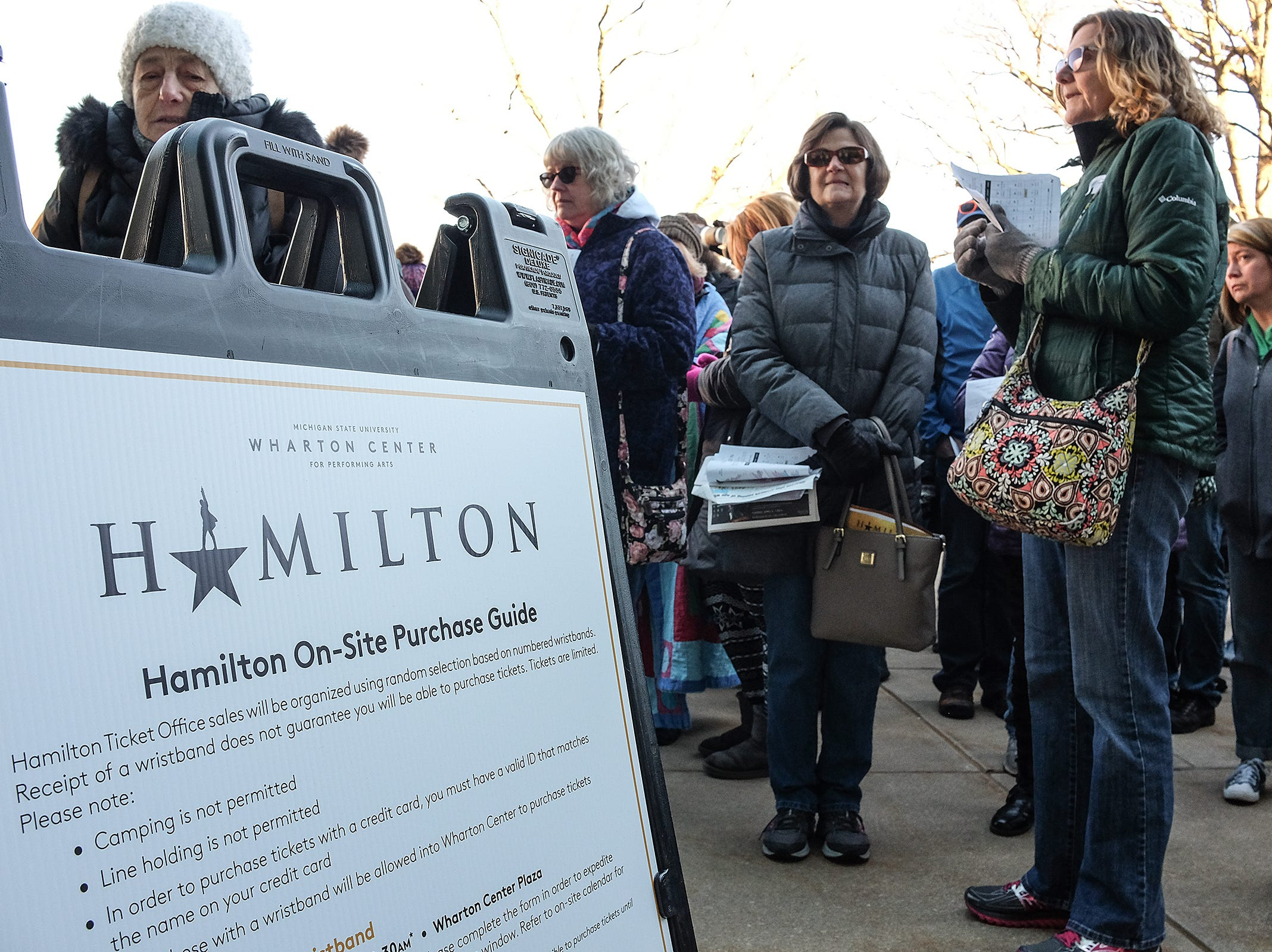 """People brave the cold temperatures for a chance to buy tickets to the Broadway Show """"Hamilton"""" outside the Wharton Center Saturday, March 23, 2019."""
