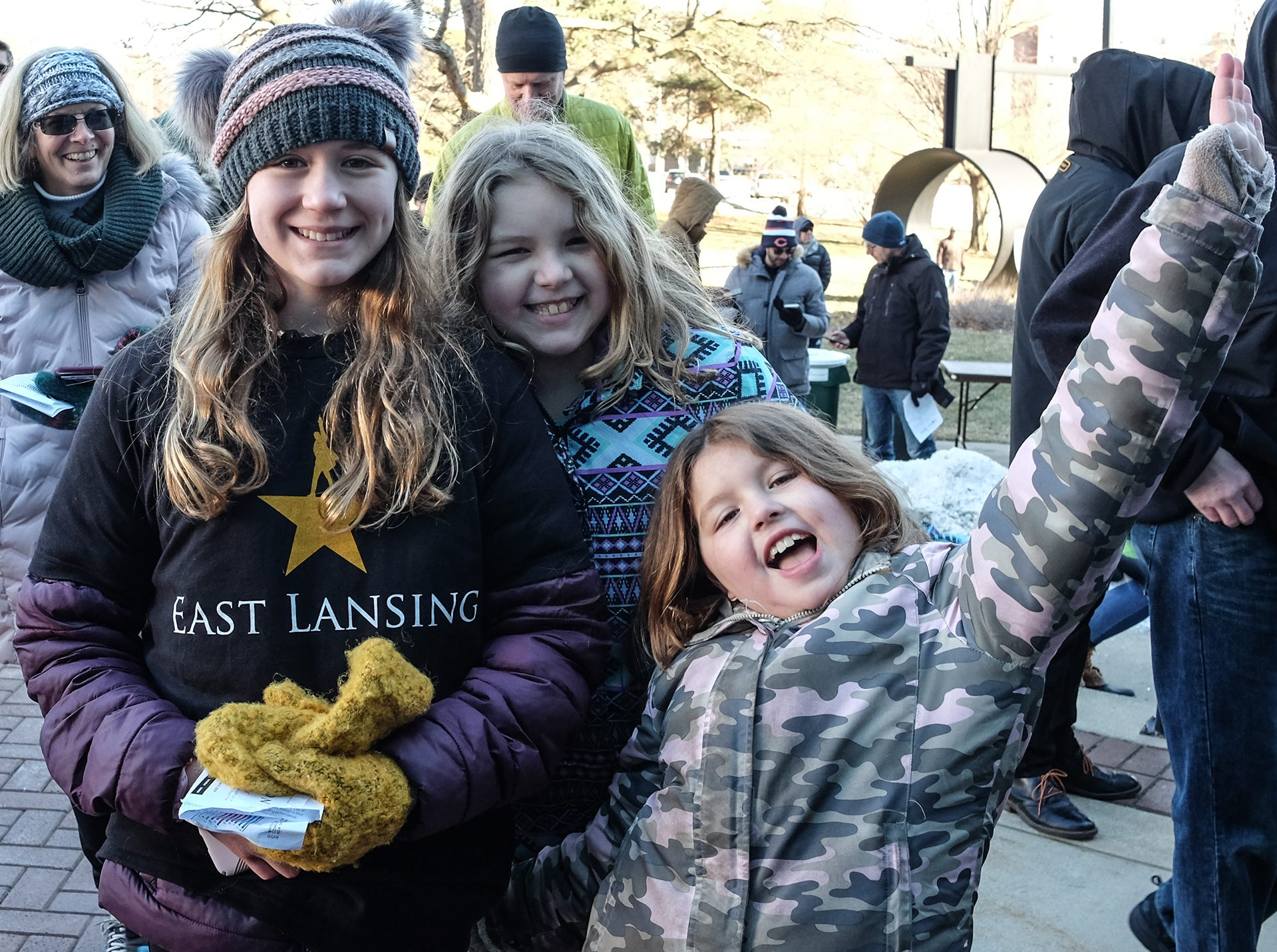 """Cousins and huge """"Hamilton"""" fans, Ella Smith, 11, left, Madison Rusnock, 10, center, and Katelyn Rusnock, 9, wait in the cold outside the Wharton Center to see if they will be selected to purchase tickets to the hit Broadway show Saturday, March 23, 2019."""