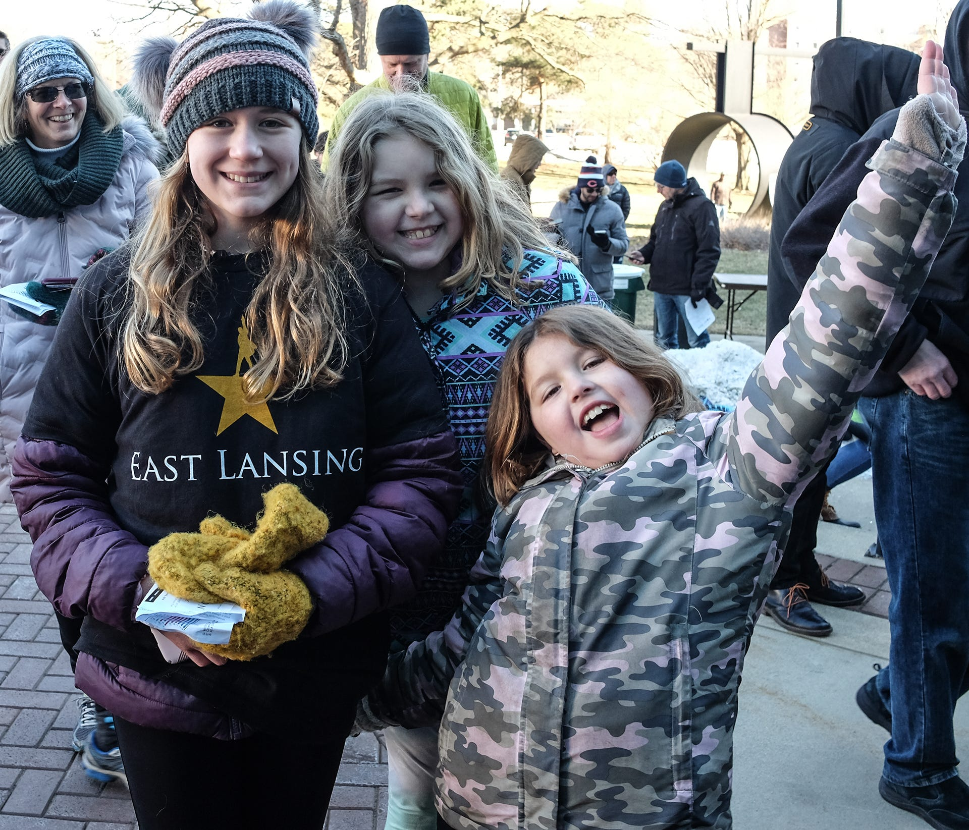 "Cousins and huge ""Hamilton"" fans, Ella Smith, 11, left, Madison Rusnock, 10, center, and Katelyn Rusnock, 9, waited March 23 in the cold outside the Wharton Center to see if they were selected to purchase tickets for a show."