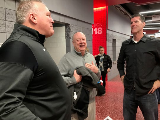 Head coach Gregg Collins reminisces with super sub Chris Smith (left) and state tournament MVP Tom Scholl in the concourse of the Schottenstein Center before Lexington's 1989 state title is honored Saturday at the state basketball tournament.
