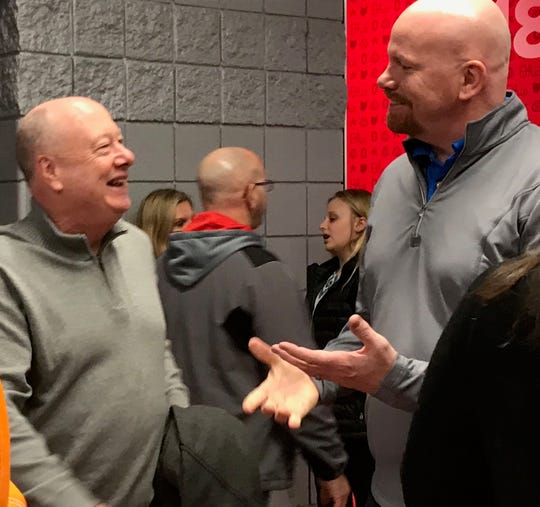 Head coach Gregg Collins and first team All-Ohioan Jeff Hoeppner relive great times before their 1989 Lexington state championship team is honored on its 30th anniversary at the state basketball tournament in Columbus.