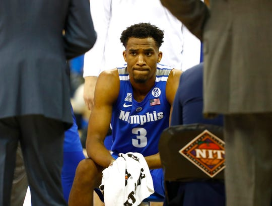 Memphis Tigers guard Jeremiah Martin (3) reacts during a timeout in the second round NIT game against Creighton Friday, March 22, 2019, in Omaha, Neb.