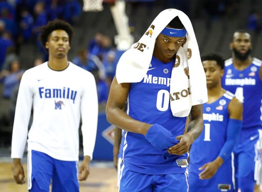 Memphis Tigers forward Kyvon Davenport (0) walks off the court after the team's loss to  Creighton in their second round NIT game Friday, March 22, 2019, in Omaha, Neb.