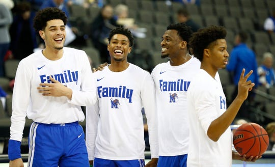 Memphis Tigers forward Isaiah Maurice (14), guard Ryan Boyce (32), forward Victor Enoh (12) and guard Jayden Hardaway (25) warm up before their second round NIT game against Creighton Friday, March 22, 2019, in Omaha, Neb.,