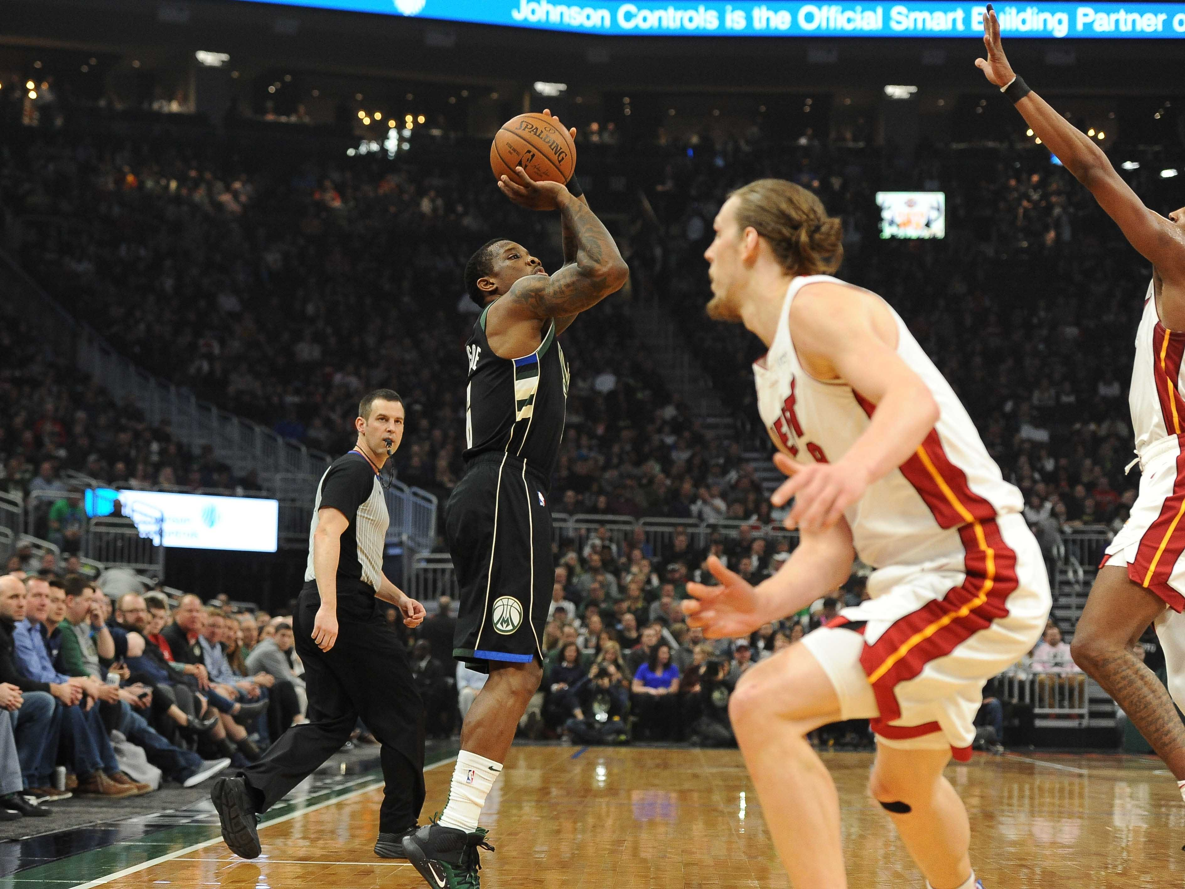 Eric Bledsoe of the Bucks launches a three-pointer against the Heat during the first quarter.