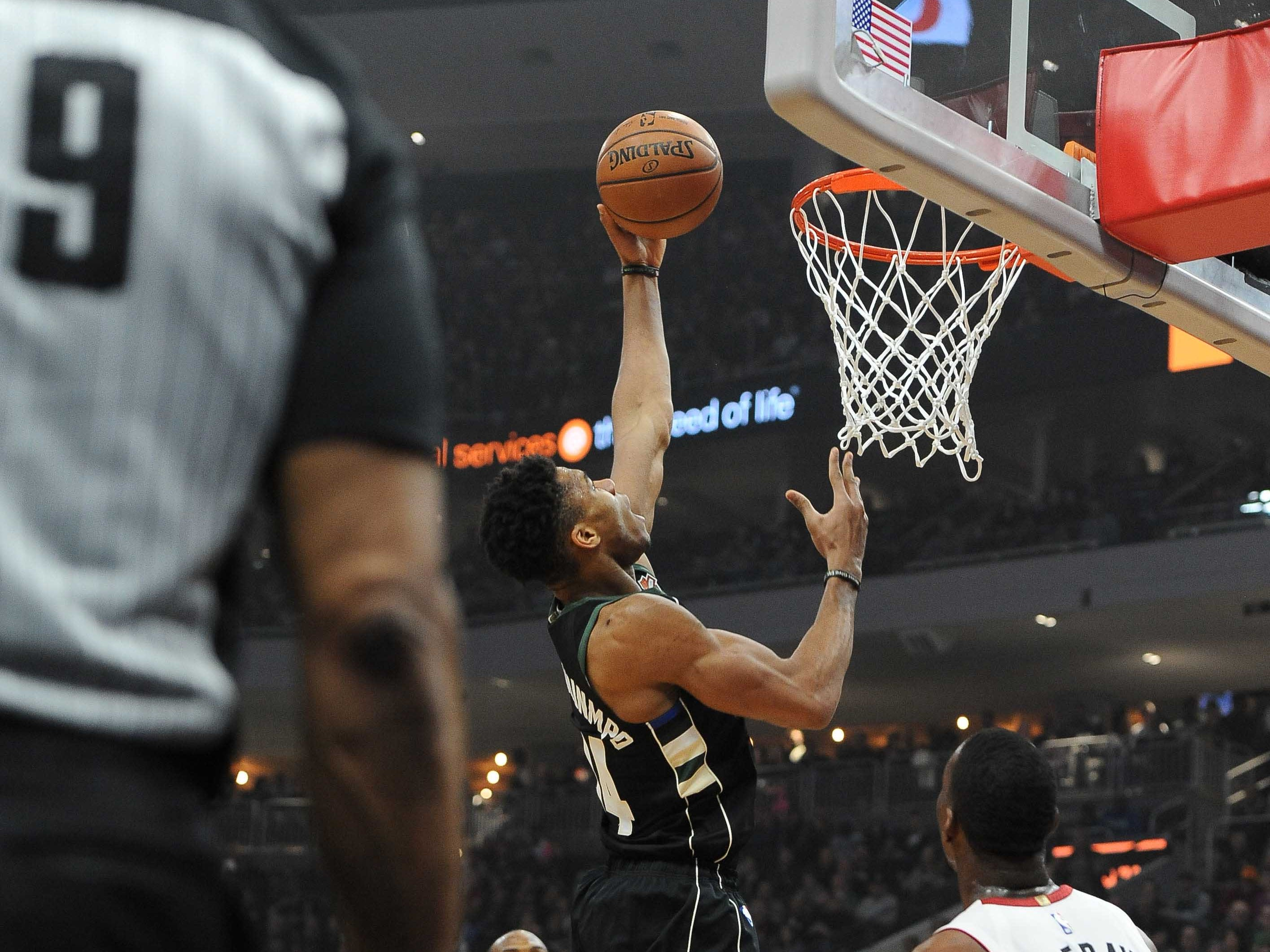 Giannnis Antetokounmpo of the Bucks goes in for a score against the Heat during the first quarter.