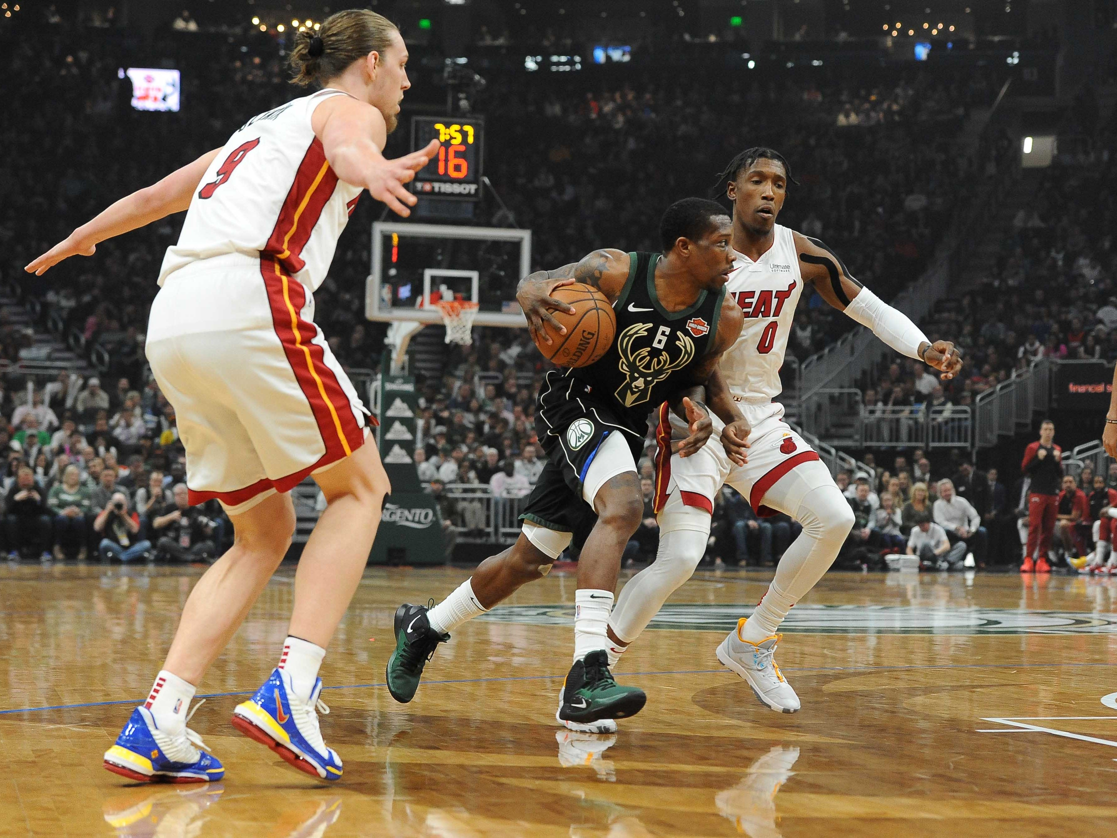 Bucks guard Eric Bledsoe scans the floor as he drives past Heat guard Josh Richardson during the first quarter.