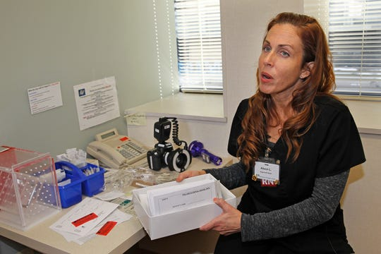 Alison Lopez, a sexual assault nurse examiner at the Aurora Healing Center at Aurora Sinai Medical Center, explains how evidence is collected from victims of sexual assault and abuse. The center treated 830 patients, an average of more than two a day, last year.