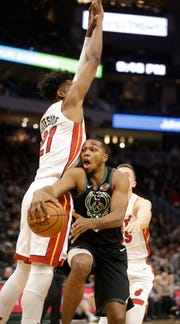 Sterling Brown passes around Miami's Hassan Whiteside during the second half of their game Friday night. Brown returned to action after missing 13 games over nearly a month with a right wrist injury.