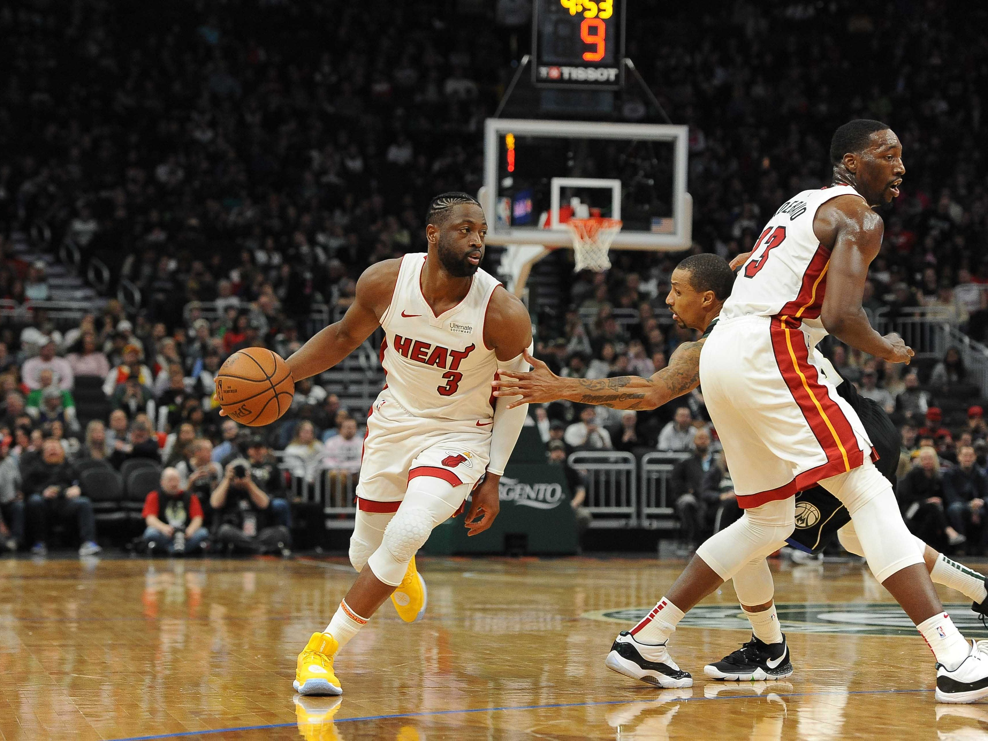 Heat guard Dwayne Wade drives around a pick during the third quarter against the Bucks. Wade, the former Marquette star, played his final regular season game in Milwaukee on Friday night.