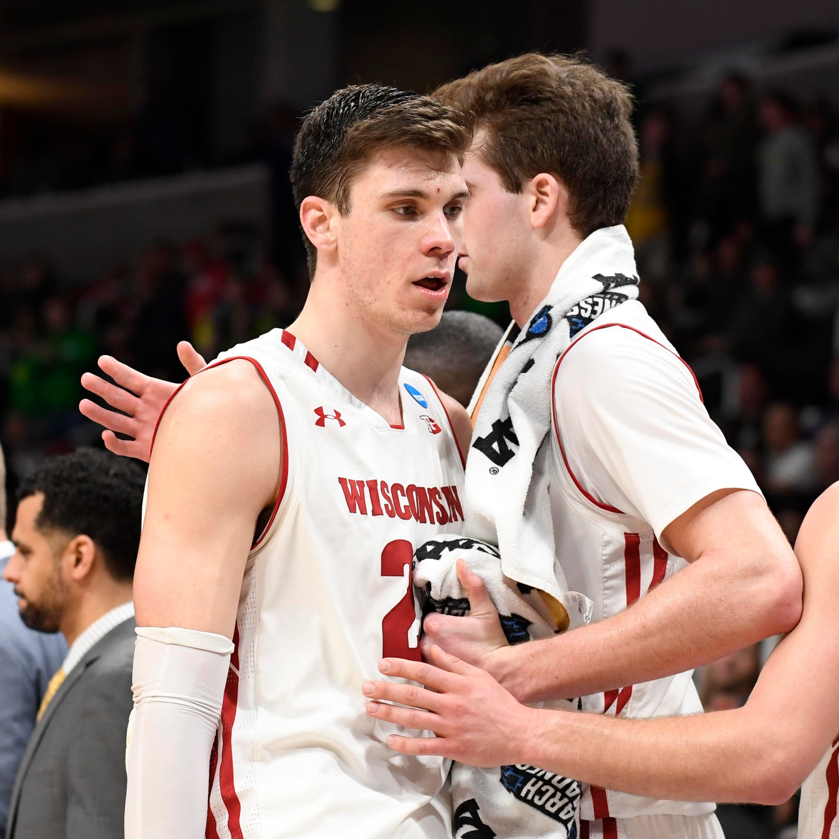 Ethan Happ and the Wisconsin Badgers react during...