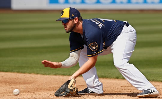 Brewers second baseman Mike Moustakas fields a ground ball for an out during a game against Texas in the third inning March 19.
