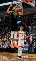 Bucks forward Giannis Antetokounmpo led all scorers with 27 points Friday night against the Heat.