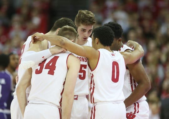 Jan 26, 2019; Madison, WI, USA; Wisconsin Badgers forward Nate Reuvers (35) talks to his teammates as they huddle before the game with the during the game with the Northwestern Wildcats at the Kohl Center. Mandatory Credit: Mary Langenfeld-USA TODAY Sports