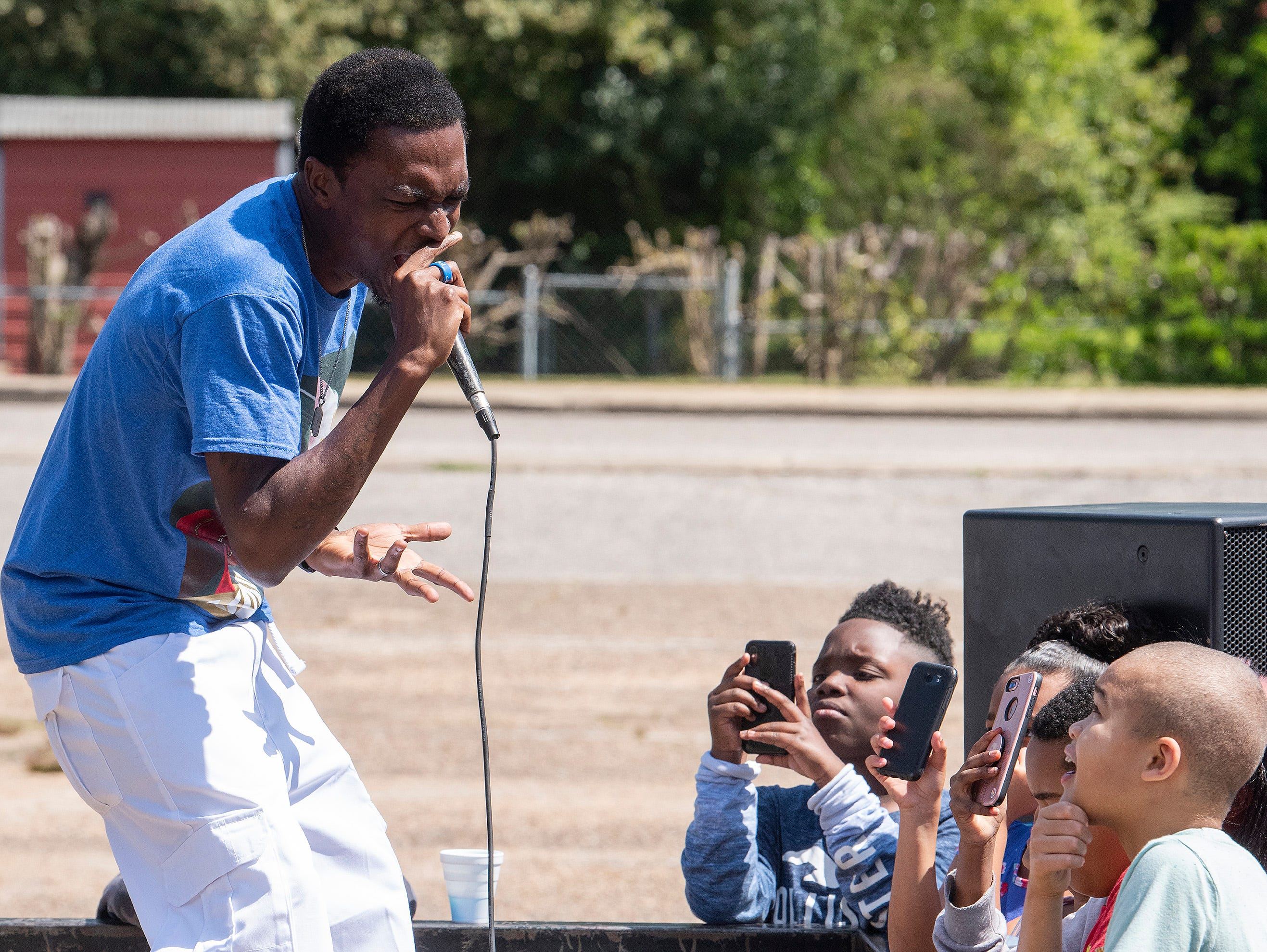 Christian rapper King Allico performs as Flatline Church hosts a block party for the Chisholm neighborhood in Montgomery, Ala., on Saturday March 23, 2019.