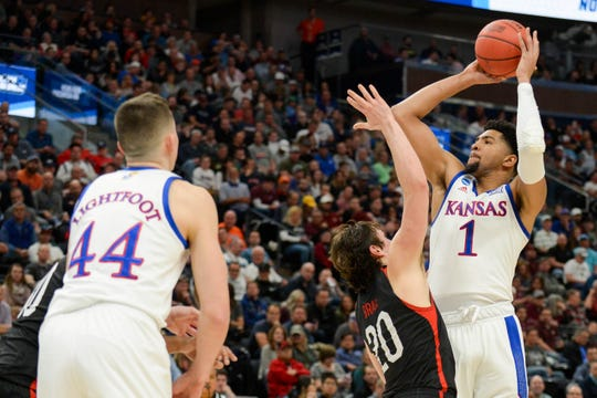 kansas forward Dedric Lawson (1) shoots over Northeastern guard Bolden Brace (20)) during the first round of the NCAA Tournament at Vivint Smart Home Arena. on March 21, 2019, in Salt Lake City.