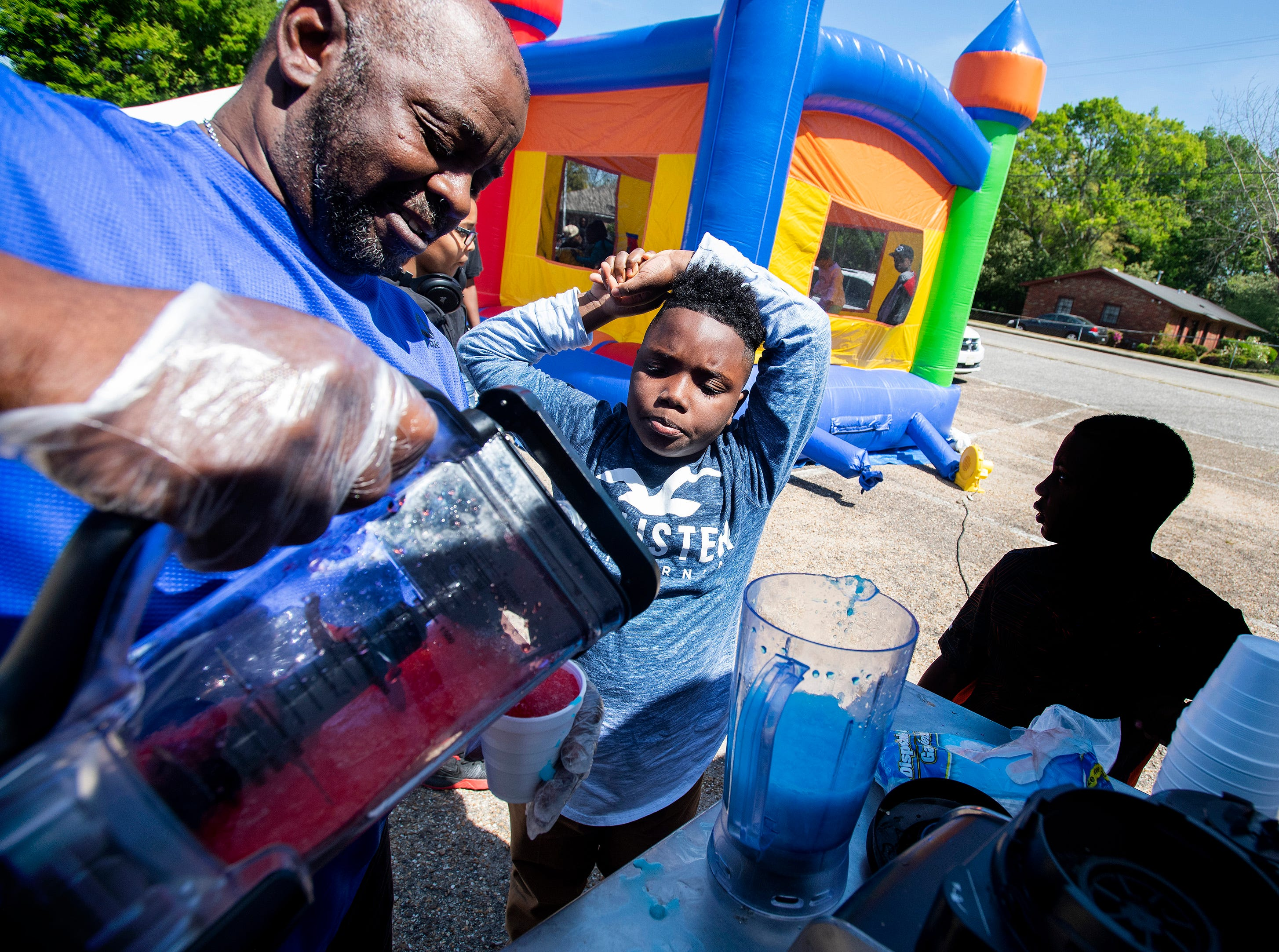 Slushies are served as Flatline Church hosts a block party for the Chisholm neighborhood in Montgomery, Ala., on Saturday March 23, 2019.