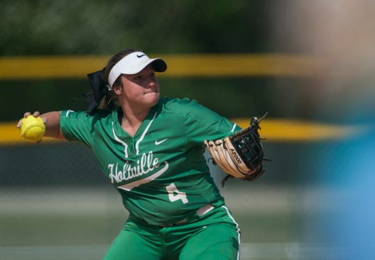 Holtville's Cyndi Thorton (4) throws the ball to first base during the Alex Wilcox Memorial Softball Tournament at Lagoon Park in Montgomery, Ala., on Saturday, March 23, 2019.