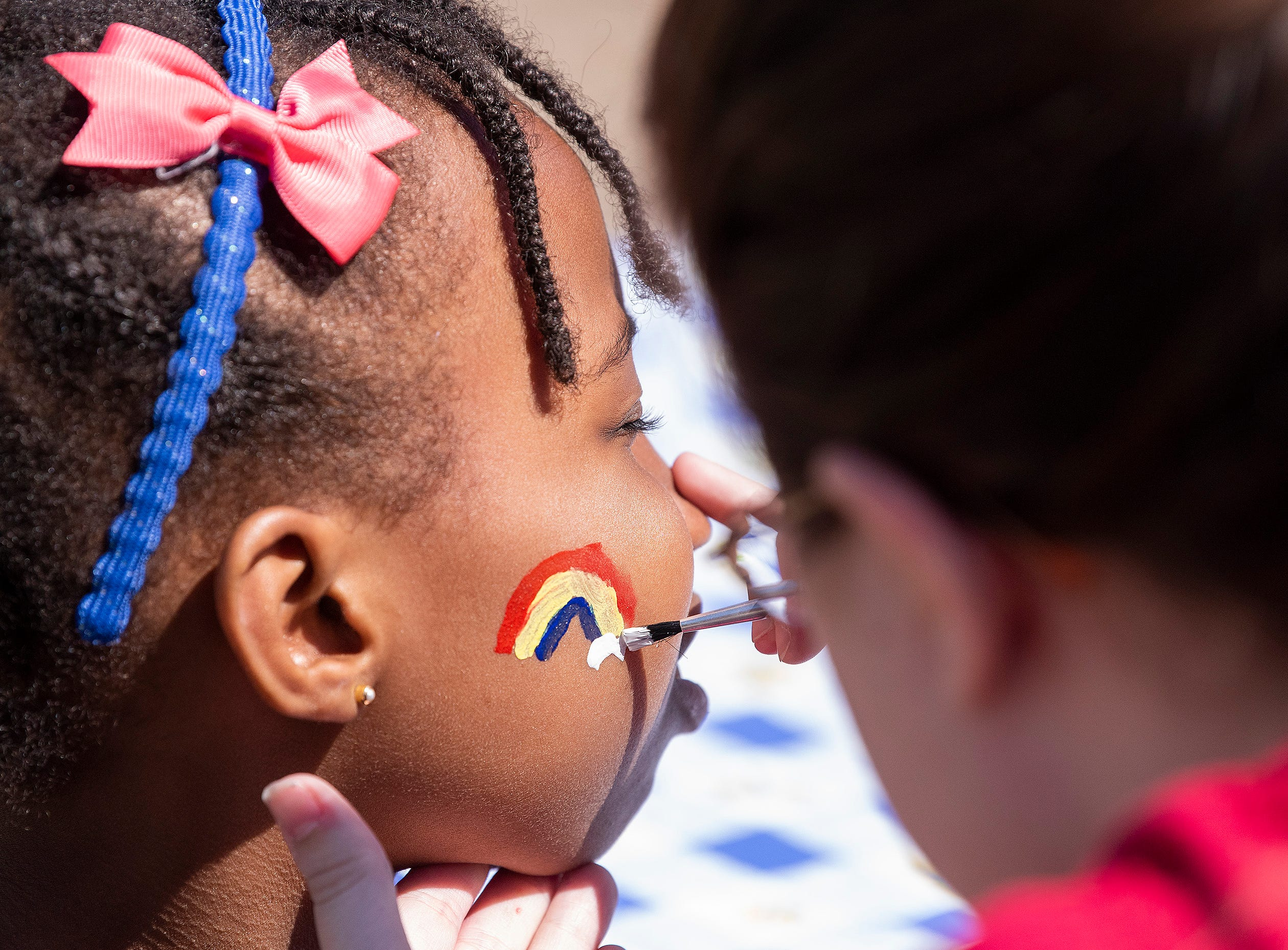Face painting as Flatline Church hosts a block party for the Chisholm neighborhood in Montgomery, Ala., on Saturday March 23, 2019.