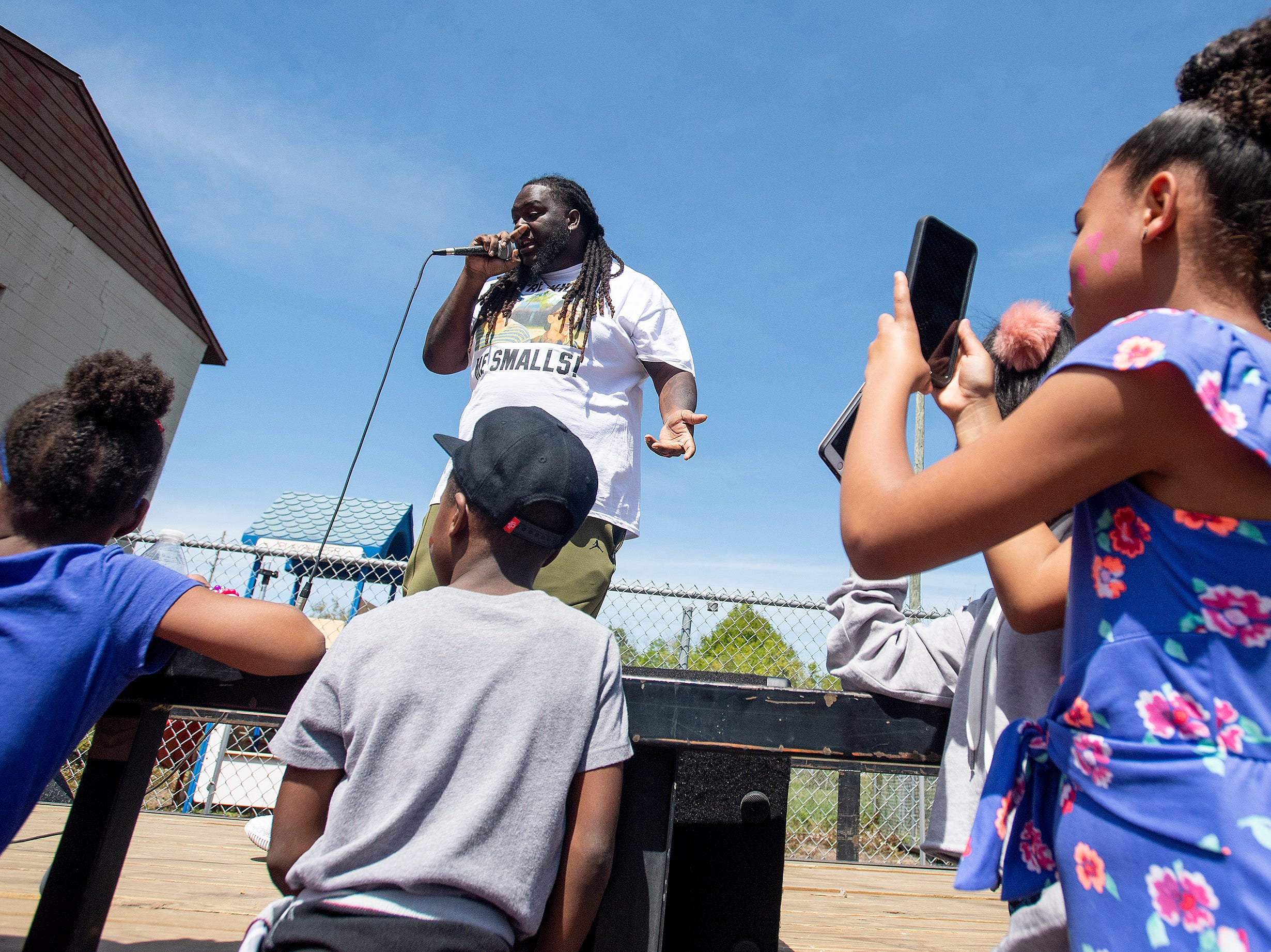 Christian rapper Freelo performs as Flatline Church hosts a block party for the Chisholm neighborhood in Montgomery, Ala., on Saturday March 23, 2019.
