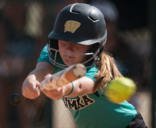Wetumpka's Ashlynn Campbell (38) misses the ball during the Alex Wilcox Memorial Softball Tournament at Lagoon Park in Montgomery, Ala., on Saturday, March 23, 2019.