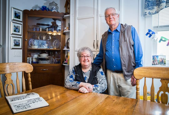 Roy Harris and Linda Horner sit at the dining table where Roy proposed to Linda at their Winchester home. The couple met when they were in middle school.