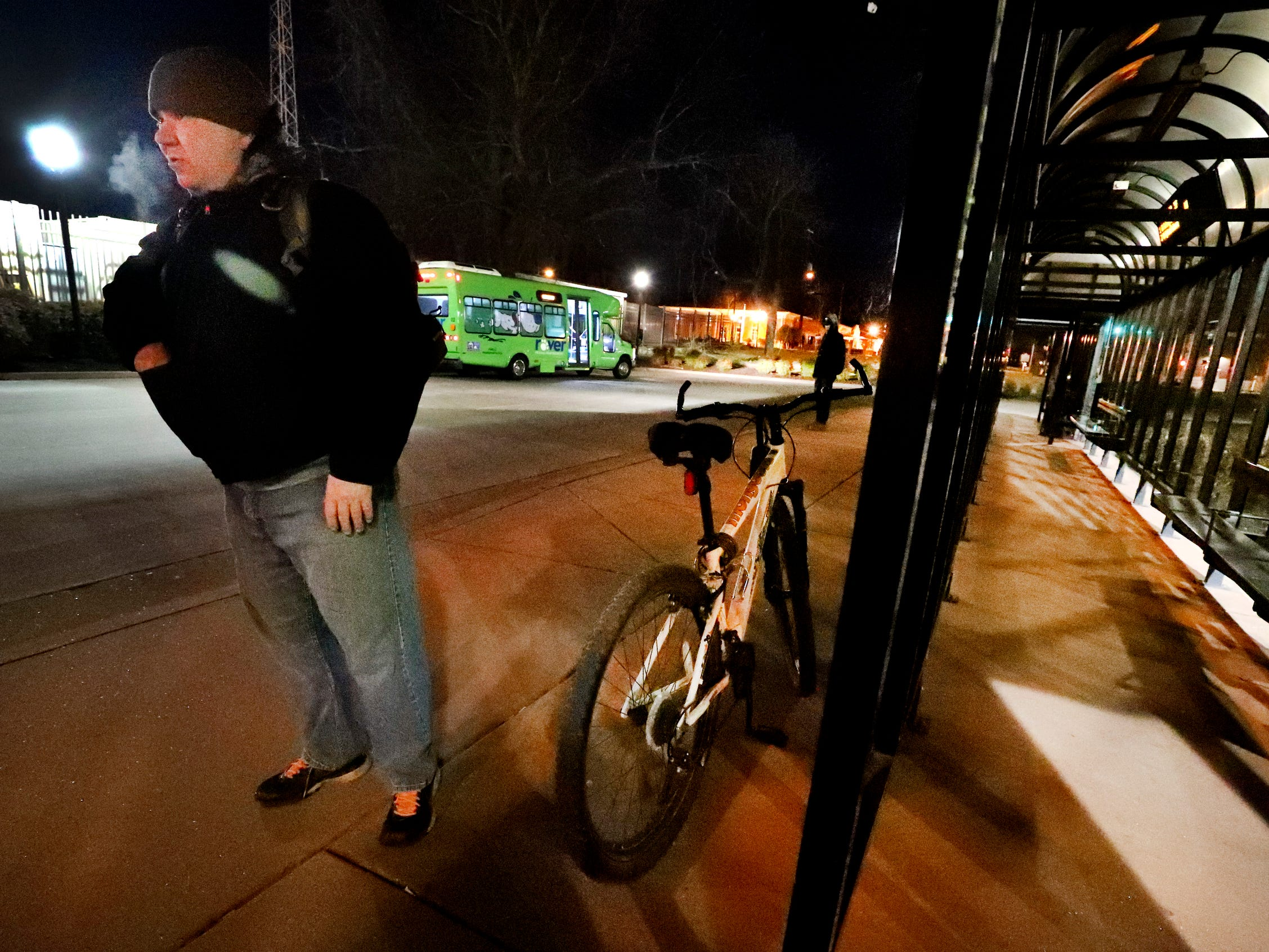 Daniel Zienkiewicz gets to wait a few minutes before his bus arrives on Wednesday, March 18, 2019, in Murfreesboro, Tenn.. Zienkiewicz said that the bus stop has heaters but they aren't turned on early enough for him to use but he said he was already warm from the bike ride anyway.