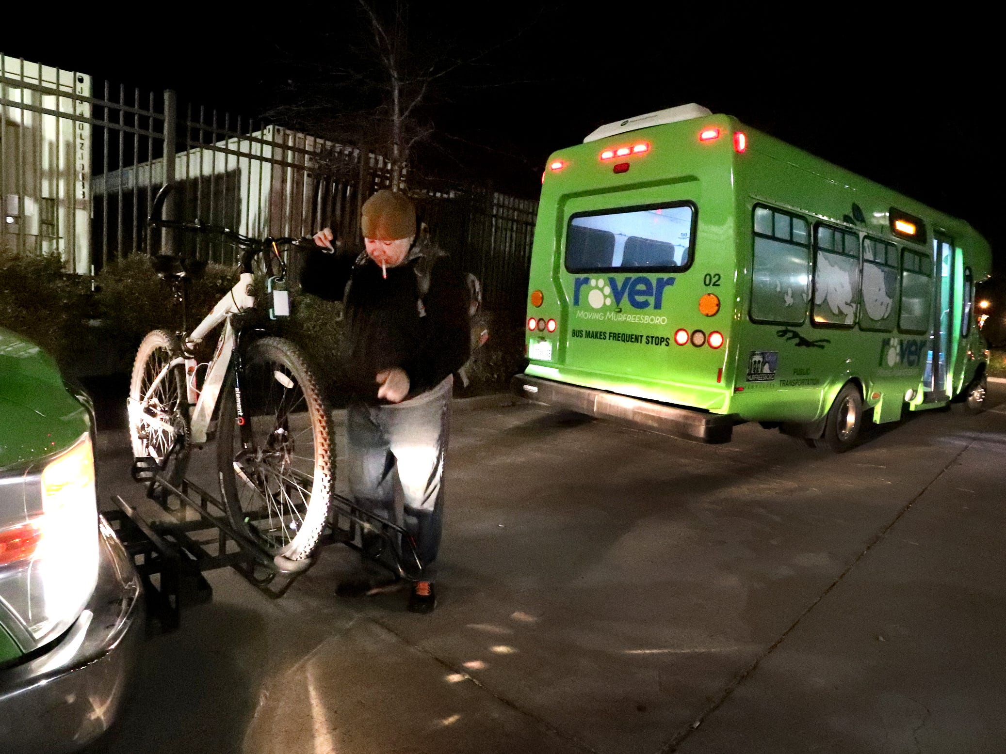 Daniel Zienkiewicz places his bike on one of the front two bike rakes in front of his Rover bus. on Wednesday, March 18, 2019, in Murfreesboro, Tenn.., before boarding the bus. Zienkiewicz says that if there are more than 2 people with bikes the others must wait for the next bus.